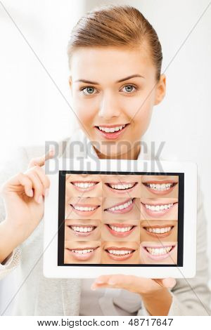 healthcare, medical and stomatology - female doctor with tablet pc and smiles