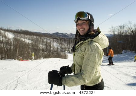 Smiling Woman Skiing On Hill