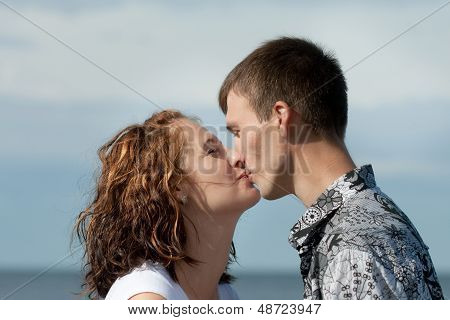 Man And Woman Are Kissing Outdoors