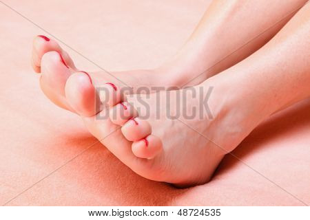 Woman Feet With Red Toenails On Towel