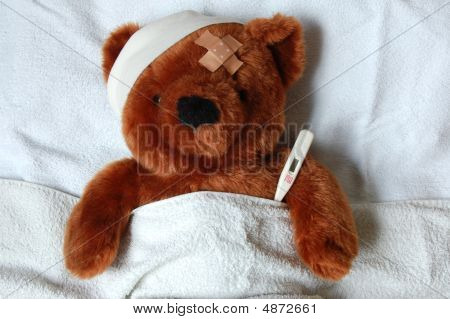 Sick Teddy With Injury In Bed