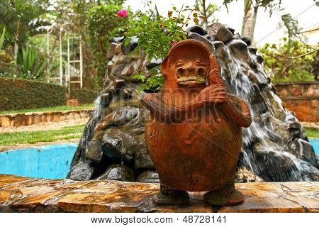 Fat Little Statue On Water Fountain