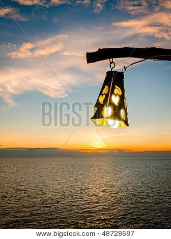 Silhouette Of Bright Lantern During Sunset At Dusk