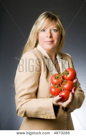 Attractive Blond Woman With Bunch Tomatoes Fresh  For Healthy Life