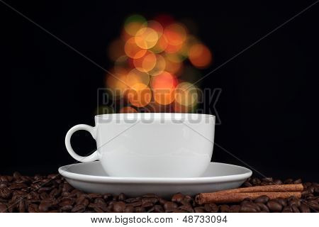 Cup of coffee with coffee beans on a beautiful background