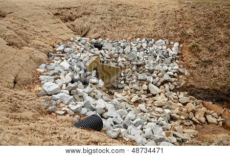 Gravel Stones Around Overflow Drain