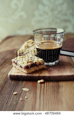Homemade flapjack with a glass of espresso