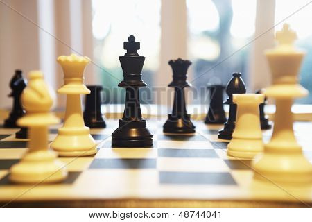 Chess pieces standing on chess board