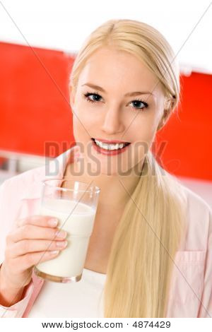 Woman With Glass Of Milk