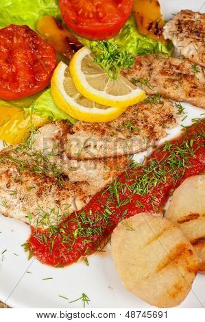 Tasty fish pike perch fillet with vegetables and sauce