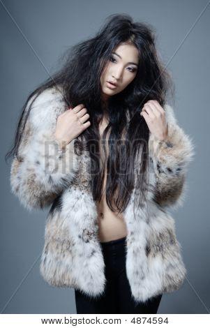 Asian Beauty In Fur Coat