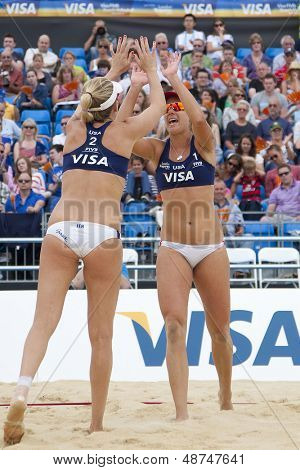 12/08/2011 LONDON, ENGLAND, Jennifer Kessy & April Ross (USA) celebrate winning their match during the FIVB International Beach Volleyball tournament, at Horse Guards Parade, Westminster, London.