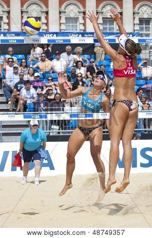 10/08/2011 LONDON, ENGLAND, Heather Bansley & Elizabeth Maloney (CAN) vs Alejandra Simon & Andrea Garcia Gonzalo (ESP) during the FIVB Beach Volleyball, at Horse Guards Parade, Westminster, London.