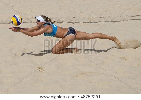 10/08/2011 LONDON, ENGLAND, Heather Bansley (CAN) dives for the ball during the FIVB International Beach Volleyball tournament, at Horse Guards Parade, Westminster, London.