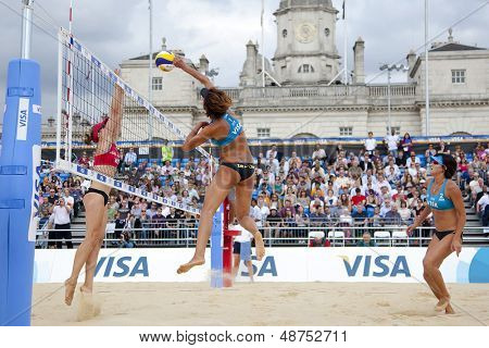12/08/2011 LONDON, ENGLAND, Kacie MacTavish & Julie Rodrigue (CAN) vs Chen Xue & Xi Zhang (CHN) during the FIVB International Beach Volleyball tournament, at Horse Guards Parade, Westminster, London.