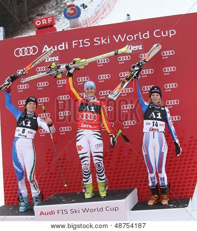 LIENZ, AUSTRIA 28 December 2009. Manuela Moelgg ITA, (L) 2nd Kathrin Hoelzl (GER) (C) winner and Taina Barioz (FRA) (R)  3rd in the women's Audi FIS Alpine Skiing World Cup giant slalom race.