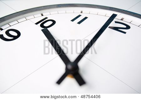 Macro shot of a clock face showing ten o�?�¢??clock