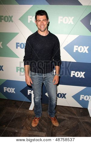 SLOS ANGELES - AUG 1:  Max Greenfield arrives at the Fox All-Star Summer 2013 TCA Party at the SoHo House on August 1, 2013 in West Hollywood, CA