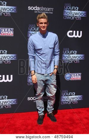 LOS ANGELES - AUG 1:  Cody Simpson arrives at the 2013 Young Hollywood Awards at the Broad Stage on August 1, 2013 in Santa Monica, CA