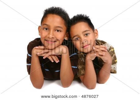 Two Hispanic Young Brothers Smiling