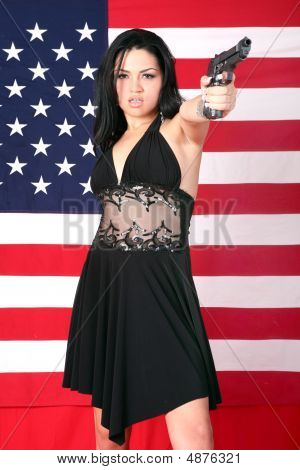 Beautiful Hispanic Model Holding A 9Mm Gun