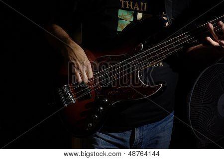 Playing an fretless bass guitar