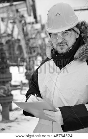 Worker In An Oil Field