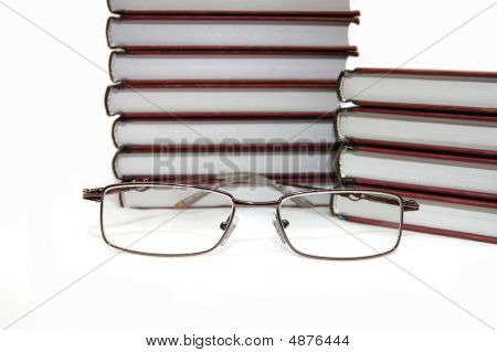 Eyeglasses Laying About Books