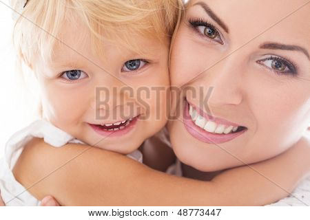 Portrait of a happy mother and her daughter isolated