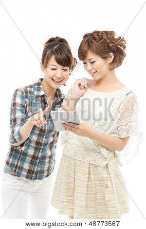 Beautiful asian women using a tablet computer