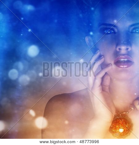 Portrait of a beautiful girl with a necklace covered in mystic blue and red lights