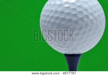 Golf Ball And Tee With Green Background