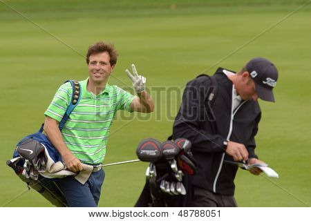 MOSCOW, RUSSIA - JULY 27: Pablo Martin Benavides of Spain with his caddie during 3rd round of the M2M Russian Open at Tseleevo Golf & Polo Club in Moscow, Russia on July 27, 2013