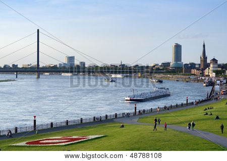 DUSSELDORF, GERMANY - JUNE 29: Barges on the Rhine river in Dusseldorf, Germany on June 29, 2013. Rhine is one of the world'??s most busiest waterways