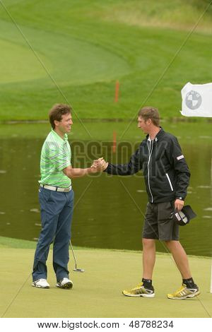 MOSCOW, RUSSIA - JULY 27: Pablo Martin Benavides of Spain handshakes with his caddie during 3rd round of the M2M Russian Open at Tseleevo Golf & Polo Club in Moscow, Russia on July 27, 2013