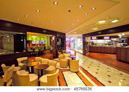 MONTE CARLO, MONACO - JULY 13: Indoor restaurant in Metropole Shopping Center with luxury shops and boutiques is one of the popular resorts and places to visit in Monte Carlo, Monaco on July 13, 2013.