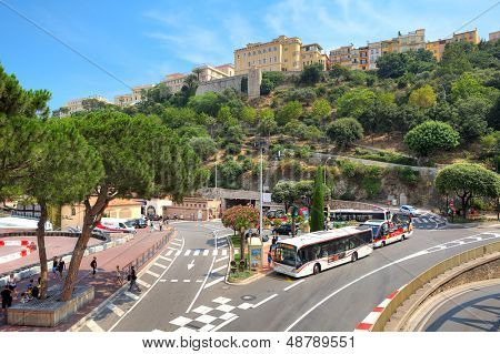 MONTE CARLO, MONACO - JULY 13: Urban road with buses which is used for Formula One races and Monaco-Ville quarter on the hill where located residence of Prince in Monte Carlo, Monaco on July 13, 2013.