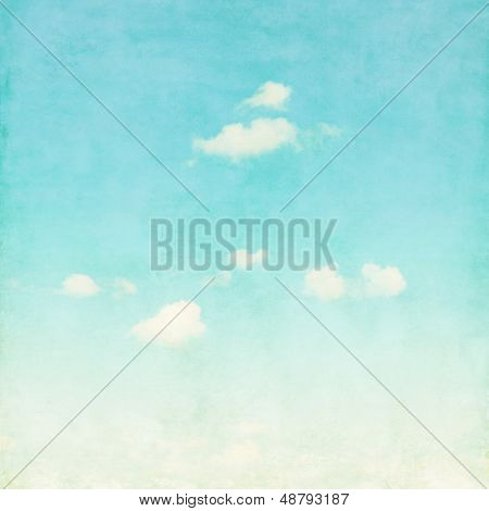 Grunge background of blue sky with  clouds.