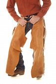 stock photo of crotch  - A cowboy is standing with his hands in his belt loops - JPG