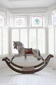 picture of bay horse  - Antique rocking horse in bay window with stained glass - JPG
