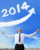 stock photo of happy new year 2013  - happy new year 2014 Business man hug 2014  - JPG