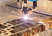 stock photo of ignite  - Plasma cutting metalwork industry machine with sparks - JPG