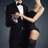 image of fine art portrait  - Art photo of a young couple in sensual lingerie and a tuxedo - JPG
