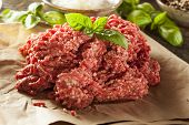 stock photo of ground-beef  - Organic Raw Grass Fed Ground Beef on Butcher Paper - JPG
