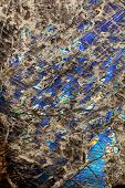 foto of labradorite  - Detail close up of the patterns and colours in the feldspar mineral Labradorite - JPG