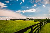 Beautiful Summer Sky Over Fence And Estate In Southern York County, Pennsylvania.