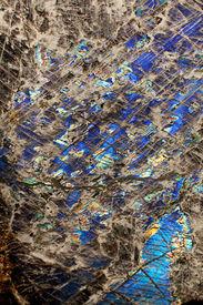 foto of feldspar  - Detail close up of the patterns and colours in the feldspar mineral Labradorite - JPG