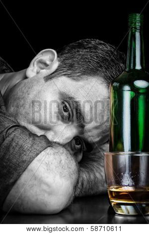 Black and white image of a drunk and depressed man