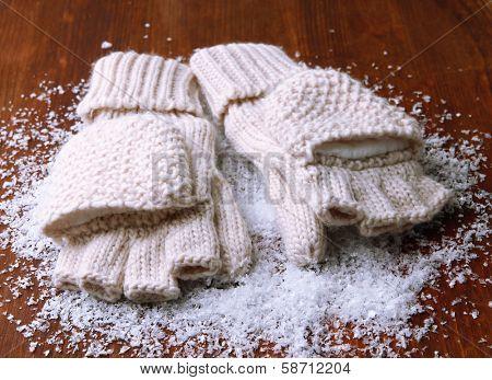 Wool fingerless gloves, on wooden background