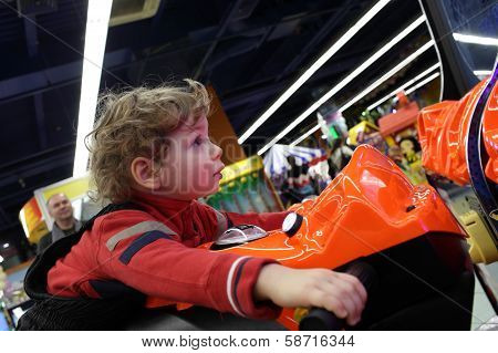 Boy Driving Motorbike Toy
